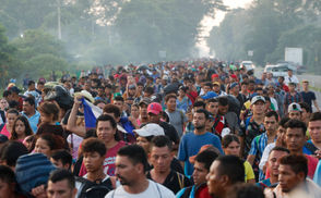 a growing throng of Central American migrants resumed their advance toward the U.S. on Sunday, Oct. 21, 2018