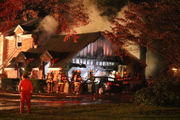 Residents displaced as fire destroys garage, cars (PHOTOS)