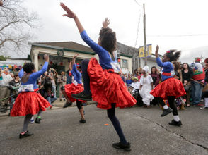 The procession commemorates New Orleans' historical bond with Haiti. In the early 1800s a tide of immigrants fleeing a slave revolt in what is now Haiti doubled the population of New Orleans, leaving an indelible mark on the city that is sometimes described as the most northern outpost of the Caribbean. Kanaval is the Haitian translation of Carnival.