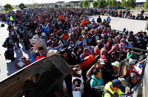 Migrants in a caravan of Central Americans scrambled to reach the U.S. border on Wednesday, Nov. 14, 2018