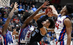 Etowah's Trent Davis is swarmed by a trio of Center Point defenders during the AHSAA Northeast Regional Class 5A championship game at Jacksonville State University in Jacksonville, Ala., Thursday, Feb. 21, 2019. (Mark Almond | preps@al.com)