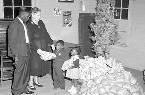 "The History Channel writes: ""The story's message-the importance of charity and good will towards all humankind-struck a powerful chord in the United States and England and showed members of Victorian society the benefits of celebrating the holiday."" (The photo above is from a 1953 Christmas event in Montgomery.)"
