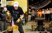 That's hot: Gene Koss and his crew create a glass sculpture for a YAYA crowd