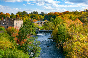 This is the view from the W. Main Street bridge. The Salmon River runs right through the center of the village and once provided power to many early mills, including the Horton Mill seen here. Photo by Kathe Harrington. - A Day in Malone Kathe Harrington
