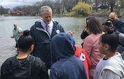 Massachusetts Gov. Charlie Baker helps stock Jamaica Pond with fish, provides lunch for cormorants