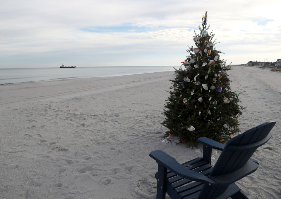 A Christmas tree, with make-your-own clam shell ornaments, is set up on Normandy Beach in Toms River, Wednesday, Dec. 19, 2018.