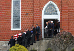 Family carefully carries the casket of Nancy Run firefighter Jared Rampulla as services were held on Nov. 19, 2018, at Schoeneck Moravian Church in Nazareth. Rampulla died Nov. 12 in a crash in Bushkill Township.