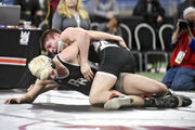 Results, highlights and more from MHSAA team wrestling state quarterfinals