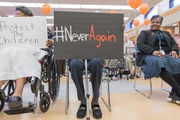 Senior citizens in wheelchairs show support for students marching in anti-gun rallies Saturday