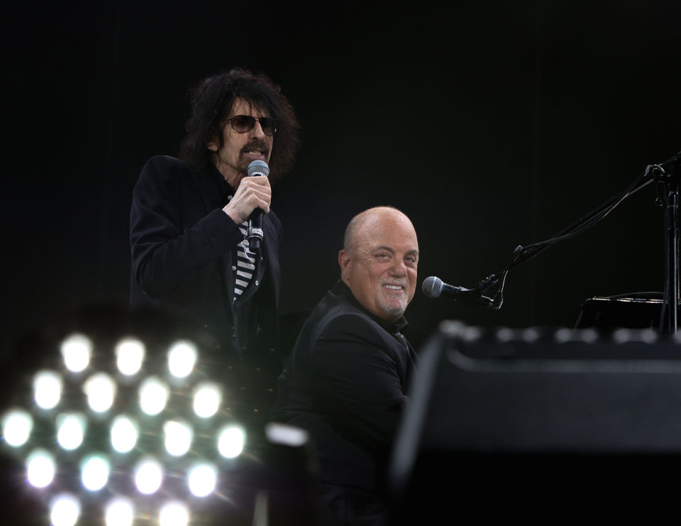 Billy Joel was joined by J. Geils Band frontman Peter Wolf and Def Leppard lead singer Joe Elliott at Fenway Park in Boston.