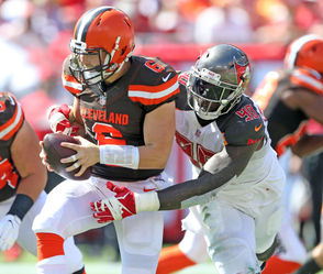 "CLEVELAND, Ohio -- Rookie quarterback Baker Mayfield went 23-of-34 for 215 yards and two touchdowns in the Cleveland Browns' 26-23 overtime loss at the Tampa Bay Buccaneers on Sunday afternoon. Mayfield was sacked five times and had four carries for 43 yards. No excuses: The Browns, as is their specialty under coach Hue Jackson, found a way to lose. Actually, they found multiple ways to lose en route to falling to 2-4-1. Among the OICs at Tampa: The Browns lost to a mediocre-to-bad outfit despite a +3 turnover margin (4-1). Jackson is 3-35-1 as Browns coach. Not all of it is his fault, of course, but a coach who is 3-35-1 with a franchise should be amazed he lasted long enough to achieve such spectacular ineptitude. Jackson is a symbol of losing in a result-oriented business, with a game at Pittsburgh next. Mayfield's day: I wasn't sure what I was watching from the Browns offense in the first half. It was as if Mayfield had training wheels on; the Browns largely declined to challenge a legitimately bad defense with anything downfield -- a ""prevent offense.'' It would have been understandable if Mayfield were making his debut, or if the Buccaneers were scary-dominant. Neither was true. Only in the second half did Mayfield begin to excel. He made enough plays to orchestrate a comeback and could have won an ugly game, but it didn't happen for various reasons beyond his control. Mayfield missed some throws and held onto the ball too long several times. Regardless, he is far down the list of players to blame for the latest defeat. Final grade: C+"