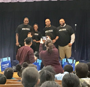 Staten Island native and retired 10-year NFL veteran Adewale Ogunleye (far left) returned to Park Hill on Tuesday for his Goal Power Foundation's fourth annual turkey giveaway at his alma mater, PS 57. He was joined by TV/radio personality K Foxx, as well as retired NFL defensive tackle Damian Gregory (far right) and former Buffalo Bills linebacker Akin Ayodele as the group gave out turkeys to each of the school's third and fourth-graders. District Attorney Michael McMahon and the Carter Foundation also joined in on the giving.
