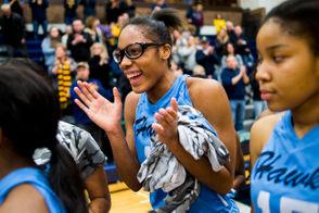 Flint Hamady junior Aryana Naylor smiles as she celebrates the 56-34 victory over Royal Oak Shrine Catholic during the 2019 MHSAA Division 3 girls basketball state quarterfinal game on Tuesday, March 19, 2019 at Lapeer High School. Flint Hamady will advance to the state semifinal on Thursday, March 21 at Van Noord Arena in Grand Rapids. (Jake May | MLive.com)