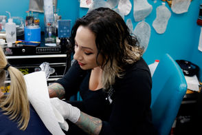 """Serpica said she takes pride in being a female tattoo artist, but she knows she's not the first and only one. Let's be real: The idea that tattooing is a """"boys only club"""" is a long forgotten myth. """"Female artists are pretty accepted now,"""" said Serpica, who rocks too many tats to count. """"Every once in while, guys come in and look at our portfolios and are very shocked that a female did [these designs]. I'm lucky to have cultivated a crowd of people so I don't deal with that s***."""""""