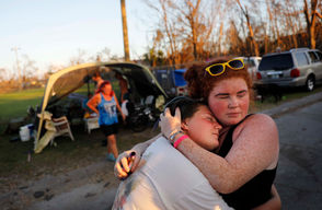 (Aurora Bilbro, left, embraces her childhood friend Ashley Bryant, both 18, in front of the tents they set up for neighbors to sleep in as their homes were damaged from Hurricane Michael in Panama City, Fla., Monday, Oct. 15, 2018. (AP Photo/David Goldman)
