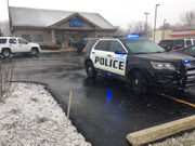 Police search for suspects after robbery at credit union