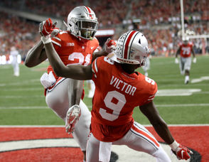 Parris Campbell (left), Ben Victor (9) and the Buckeyes have some playoff wiggle room. (Marvin Fong, The Plain Dealer)