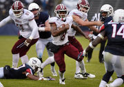 Marquis Young runs for 148 yards, UMass football beats UConn, 22-17
