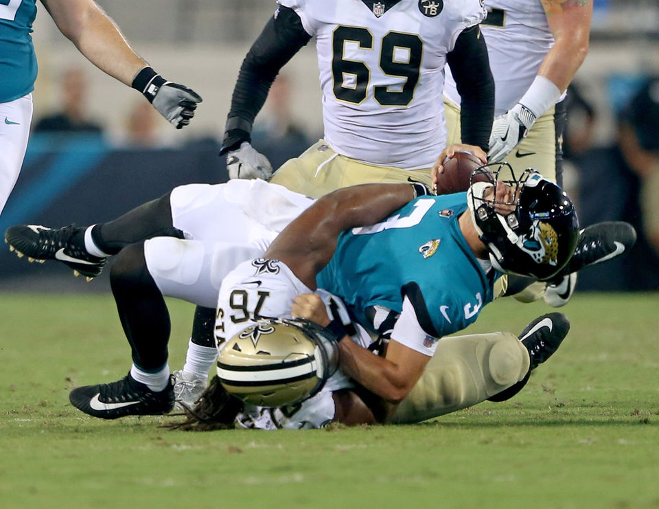 New Orleans Saints Defensive Tackle Taylor Stallworth (76) Sacks Jacksonville  Jaguars Quarterback Tanner Lee During Their Preseason Oopener At TIAA Bank  ...
