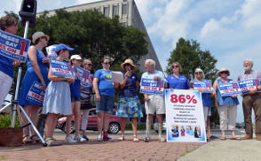 Members of the Massachusetts Nurses Association, pointing to profits earned by Massachusetts hospitals and to their own experiences at patient bedsides, marched Tuesday at the headquarters of Baystate Health in support of Question 1.