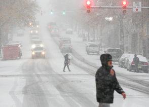 Pedestrians cross Northampton Street in Easton Thursday afternoon as heavy snow falls.