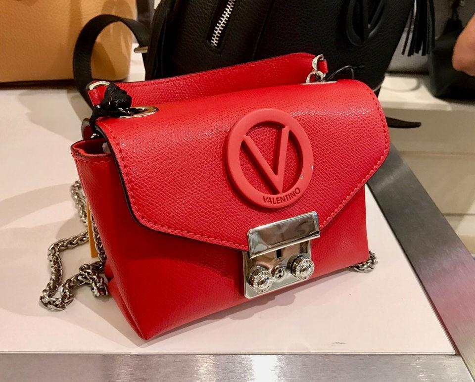 96cefe09561 This striking red Valentino bag that sells for  219.99 adorns the window at Century  21. (Staten Island Advance Carol Ann Benanti)