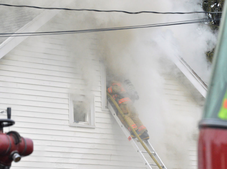 Syracuse woman dies hours after firefighters carry her out of burning house