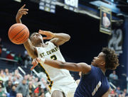 Devon Grant takes over down the stretch as Lorain boys basketball defeats St. Edward in overtime, 72-69, in Division I regional semifinal