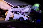 Driver crashes through garage near Alpha salon