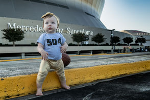 """""""This is Camille earlier this season. As you can see she is very serious about her Saints and can't wait to take that energy into the Dome when she's a bit bigger. She loves her Alvin Kamara doll and particularly likes to show everyone his nose :) Who dat!"""" -- Brennan Bergeron"""