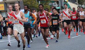Bereket Alem Kidanu (No. 435, 1:03:55) traveling along Bay Street in the Staten Island Half-Marathon won the race ~ NYRR Five-Borough Series. October 14, 2018. (Staten Island Advance/Derek Alvez).