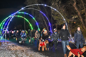 Hundreds of dogs and their owners walked lighted trail of Lights on the Lake Wednesday night.
