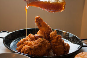 """Originally published April 2018. Can fried chicken seduce?  The folks at Modine, easily the most-anticipated new restaurant at the Jersey Shore this year, are betting the farm on their delectable signature dish -- and hoping tobecome a staple inthe foodie haven that is Asbury Park. Steve and Shanti Mignogna first came to townto open their hit pizzeria Talula's (it's across the street) in 2014. Now, their chef buddies from Brooklyn, husband-and-wife team Jill Meerpohl and Chris Davin, have migrated south as well. Andrew Rasizer serves as GM, rounding out the five-person partnership. After insurance costs killed aplan forasmokehouse with an open-flame grill, the teampivoted to""""low-country"""" fare and a Charleston theme, inspired by Meerpohl and Davis's honeymoon to the South Carolina and Georgia coasts. The name honors Meerpohl's grandmother Helen Modine Meerpohl, who her granddaughter says is a master of Southern coastal cooking and taught her the ropes. But the ridiculously delicious fried chicken recipe? That's an original."""