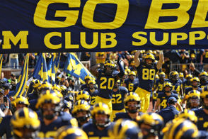 There are 48 people listed as part of the football staff on the Michigan athletics website. In addition to the 12 mentioned above, Michigan has an analytics coordinator, a director of recruiting, a recruiting operations coordinator, two assistant recruiting coordinators, a director of high school relations, four assistant strength coaches, a director of equipment and internal operations, an assistant equipment manager, a graphic designer, a multimedia coordinator, a head video coordinator, a video assistant, four offensive analysts, two defensive analysts, a senior defensive analyst, a special teams analyst, a director of performance nutrition, a director of player personnel and administration, a director of operations, a football operations administrative manager, an assistant director of internal football operations, an assistant to the head coach, an executive assistant to the head football coach, two senior advisors to the head coach, a Schembechler Hall administrative assistant, an administrative assistant, and a performance operations manager.