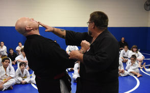 Grand Master Bart L. Ganster speaks to the students as Master and Phillipsburg Patrolman William Lance assists. As part of his regular Isshin Jitsu martial arts program at Firth Youth Center in Phillipsburg,