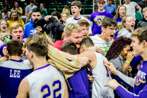 """Frankfort senior Spencer Nye smiles as he embraces senior forward Conner Smith and other players rushing the student section joyously after defeating Wyoming Tri-unity Christian 44-43 in the Division 4 boys basketball state semifinal on Thursday, Marc 14, 2019 at Michigan State University's Breslin Center in East Lansing. """"This win -- it means everything. We've been dreaming of this for so long,"""" Nye said. """"This is more than just a team. This is for the whole school, bro. It's awesome. It just awesome."""" (Jake May 
