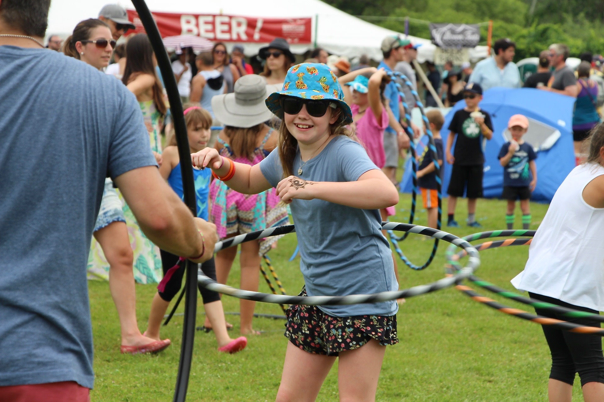Skylar Laws hula hoops during Green River Festival on July 14, 2018.