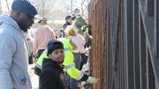 Painters' Union volunteers launch massive fence fix at Snug Harbor