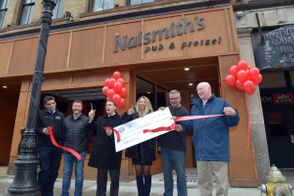 City officials gathered at Springfield's newest restaurant, Naismith's Pub & Pretzel, on Friday to celebrate the official opening of the business as the first recipient of a Downtown Dining District Restaurant loan.