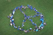 WATCH: Kids, seniors form human peace symbol. We got the birds-eye view