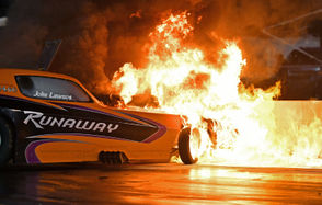 John Lawson gave the crowd a scare during Saturday night's Northern Nationals. The throttle stuck on Lawson's Nitro Nostalgia Runaway Funny Car during his burnout, and he bounced off the retaining wall. Lawson escaped his fiery hot rod and was not injured. Andy Visockis captured shots from the crash and a bunch more during Saturday's program. Please check out the slideshow below.