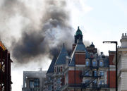 Fire burns 5-star, 115-year-old hotel in London: photos