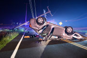 2 hurt as car takes out utility pole, rolls onto roof (PHOTOS)