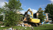 In Brad Pitt's Make It Right development, a derelict New Orleans house is demolished