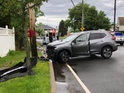 Cops: Woman accused of drunk driving after hitting utility pole