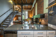 House of the Week: Converted Boston brewery houses brick loft with mezzanine