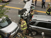 Pickup slams into parked cars, rolls on Easton street (PHOTOS)