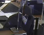 Police release photos of masked man who robbed Chase branch in Ann Arbor