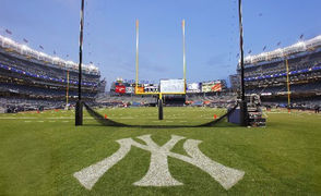 """You don't typically associate Yankee Stadium with football, but this photo of goal posts near where home plate normally resides will have you rethinking that. The photo was taken prior to the first football game at the new Yankee Stadium between ND and Army in 2010. Ryan normally treks 12 hours to Notre Dame at least once a season to visit his alma mater on game day, though I'm sure he'll appreciate the short drive to the Bronx on Saturday. """"I have not missed a game [on TV] in like 40 years!"""" said Ryan. """"I've gone to weddings with a transistor radio in my pocket. """"My son embraces it, I try to get my daughter to go...my wife's incredibly patient, she's a fan,"""" added Ryan."""