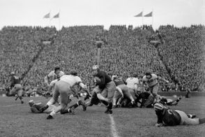 A Michigan player runs up the field during the college football game between Michigan and Ohio State at Michigan Stadium in Ann Arbor, November 22, 1941. The two teams tied, 20-20. (Ann Arbor News file photo)